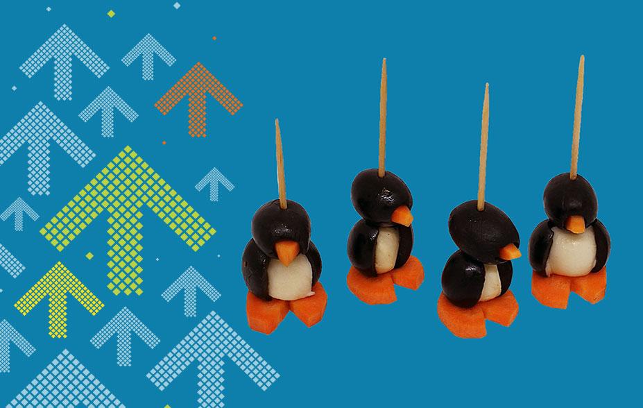 Pinguin aus Karotte, Mozzarella und Oliven
